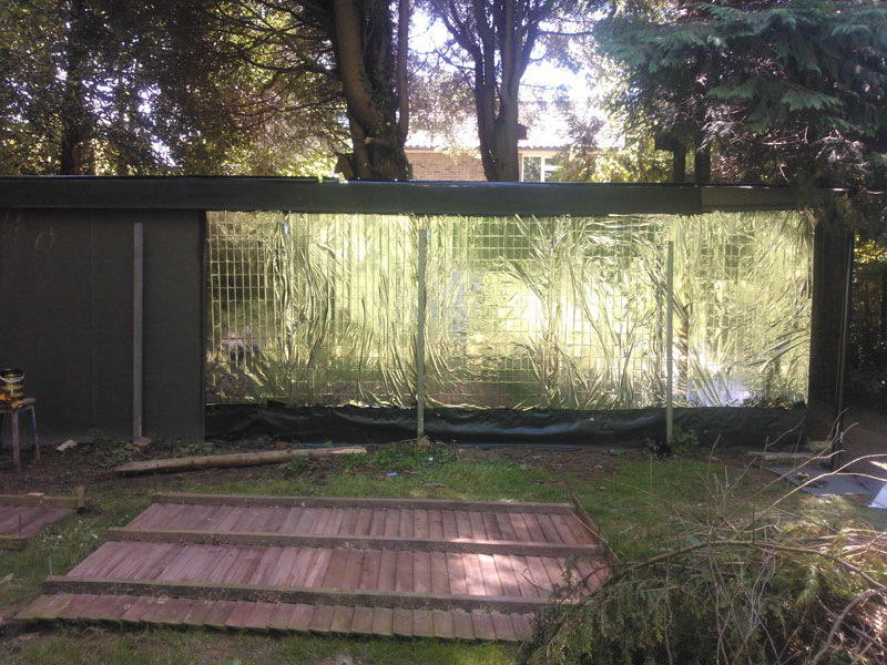 I wanted to camoflage the back of the shed and keep costs down, so I used roofing felt for the back,